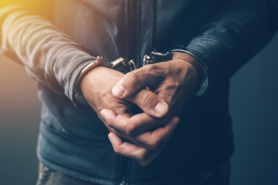 Arrested defendant with handcuffs