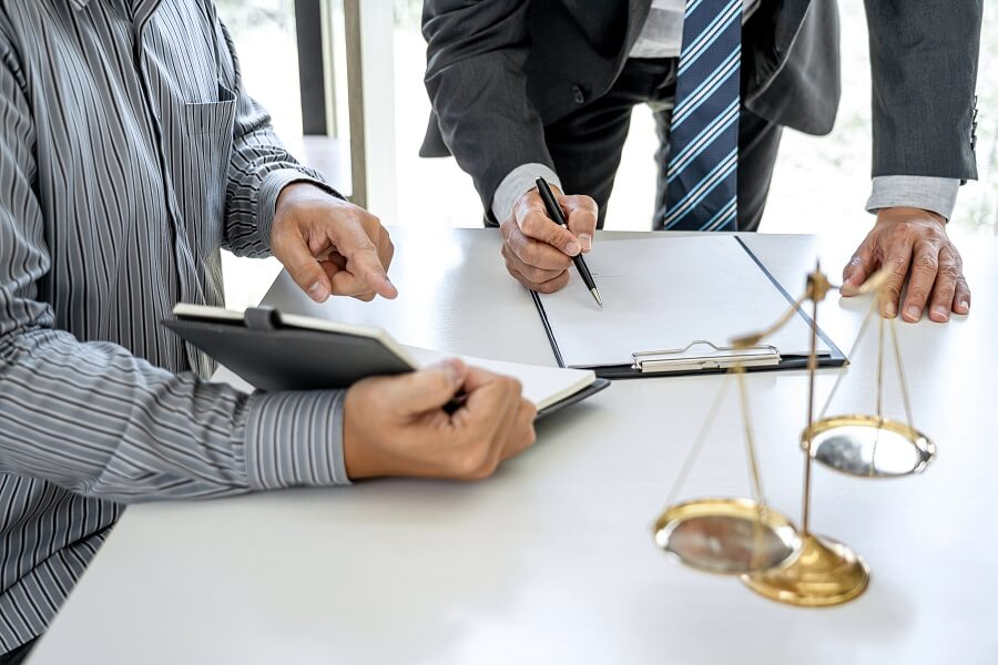 male lawyer signing a document