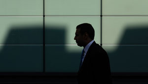 white-collar-a-man-walking-at-the-building