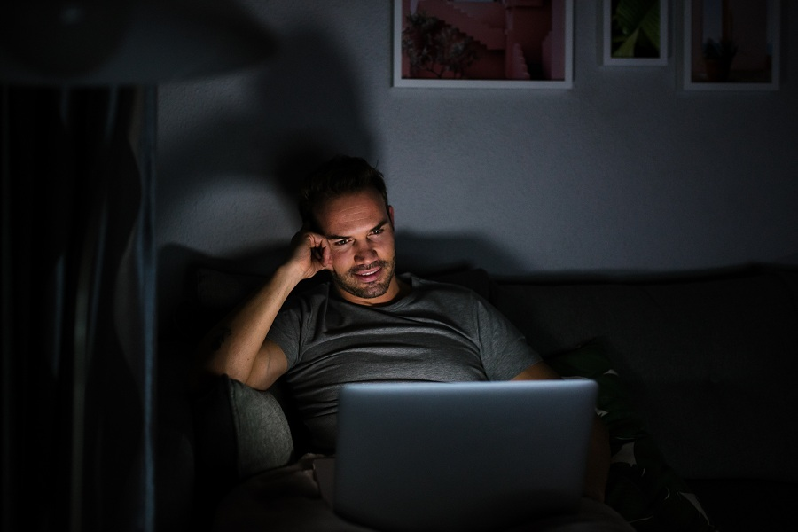 Man privately using his computer