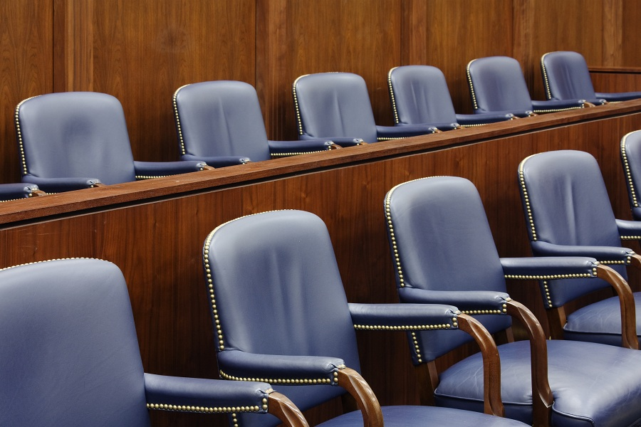 Empty jury seats in a courtroom